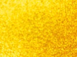 sfocatura dorata luci sfondo festivo astratto vorticoso bokeh foto