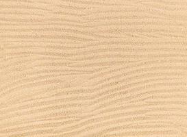 fondo di struttura delle onde di sabbia, vista dall'alto della spiaggia. foto