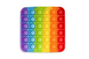 giocattolo pop it in silicone per bambini e adulti su sfondo bianco, giocattolo antistress, tendenza 2021 foto