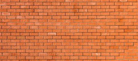 muro di mattoni rossi nuovi, ampio panorama di muratura. sfondo ideale per qualsiasi progetto. foto