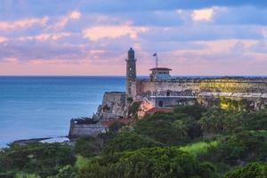 castello di morro all'avana, cuba al tramonto foto