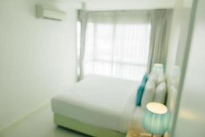 sfocatura astratta e interni e decorazioni sfocati della camera da letto foto