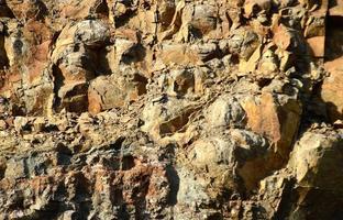 trama di pietra senza soluzione di continuità. primo piano di pietra foto