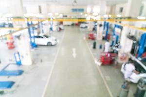 sfocatura astratta servizio di auto in garage per lo sfondo foto