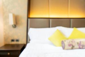 sfocatura astratta dell'interno della camera da letto dell'hotel per lo sfondo foto