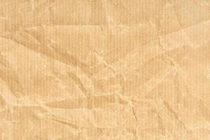 sfondo texture carta kraft stropicciata. colore marrone chiaro foto
