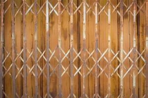 sfondo della porta di ferro vecchio e arrugginito foto