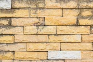 sfondo di muro di mattoni arancione grunge foto