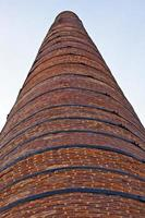 costruzione di fabbrica di mattoni in pietra camino foto