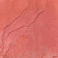 fondo di struttura di pietra grezza rossa. foto