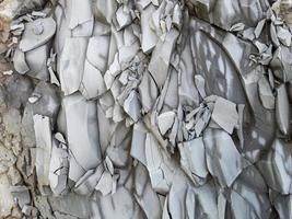 roccia di montagna con pietre grigie, caucaso. sfondo, primo piano foto