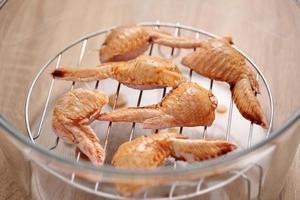alette di pollo con salsa barbecue al forno foto