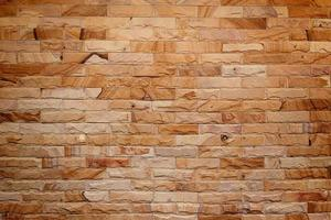 muro di mattoni marroni per lo sfondo foto