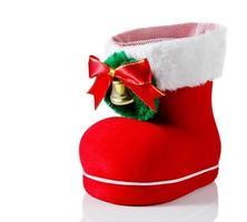 scarpe rosse di natale su sfondo bianco foto