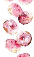 ciambelle dolci volanti isolate su sfondo bianco foto
