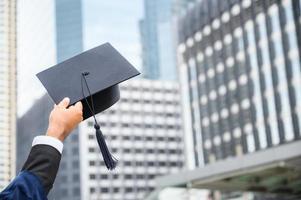 primo piano, graduazione, presa a terra, graduazione, berretto, educazione, concept foto
