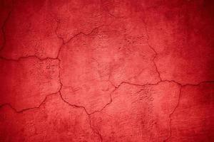 struttura della parete rossa, superficie dell'intonaco colorato, sfondo astratto foto