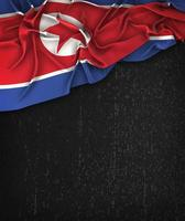 bandiera della corea del nord vintage su una lavagna nera grunge foto