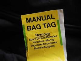 etichetta per borsa manuale foto