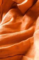 fondo di struttura del tessuto di lino arancione foto