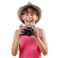 ragazza allegra con una macchina fotografica foto