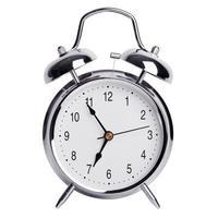 cinque minuti alle sette di una sveglia rotonda foto