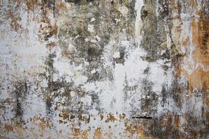 vecchia superficie in pietra intonacata foto