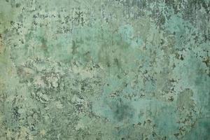 vecchia superficie intonacata di colore verde foto