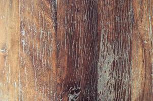 primo piano di vecchio fondo di struttura della plancia di legno marrone rosso foto