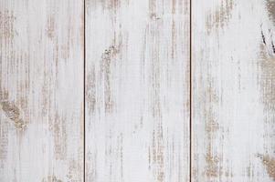 primo piano di vecchio fondo di struttura della plancia di legno marrone bianco foto