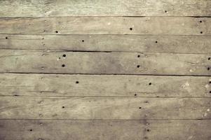 primo piano di vecchio fondo di struttura della plancia di legno marrone foto