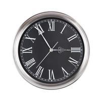 l'orologio rotondo mostra le tre meno cinque foto