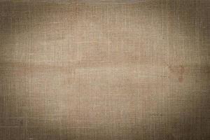 il primo piano della trama di tela marrone può essere utilizzato come sfondo foto
