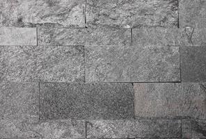 muro di piastrelle di marmo nero foto