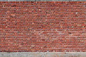 fondo del primo piano del muro di mattoni rossi foto