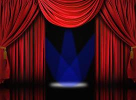 tende da palcoscenico in velluto con faretti blu foto