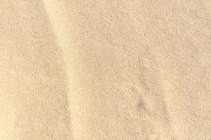sfondo trama sabbia. modello deserto marrone dalla spiaggia tropicale. foto