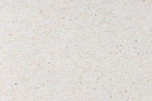 trama di sfondo di cartone riciclato. fotogramma intero foto
