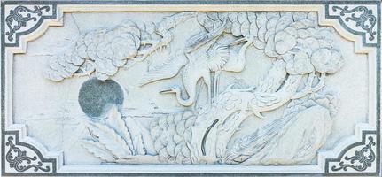 l'arte del fenicottero con la pietra. foto