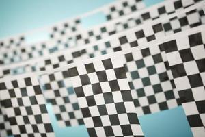 bandiera a scacchi bandiera sulla stamina foto