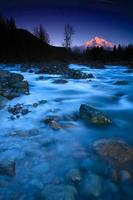tramonto sul fiume sabbioso foto