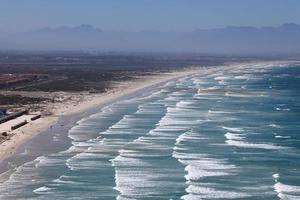 spiaggia a onde lunghe a città del capo foto