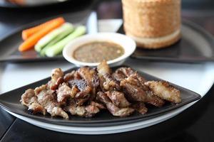 maiale alla griglia con riso appiccicoso foto