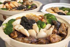 poon choi cantonese grande festa ciotole closeup foto