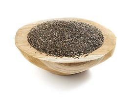 seme di chia servito in una ciotola di legno foto