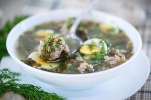 zuppa di acetosa con polpette e uova foto