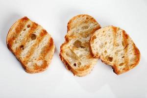 grigliare il pane tostato foto