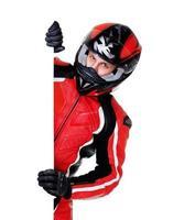 motociclista che tiene in bianco verticale foto