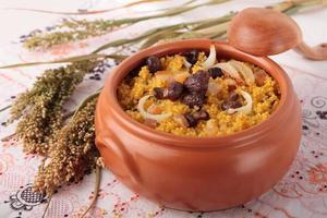 porridge di miglio con porcini, pancetta e cipolle