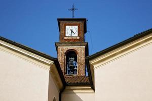 Mozzate vecchio estratto nel giorno soleggiato Milano della campana della torre foto